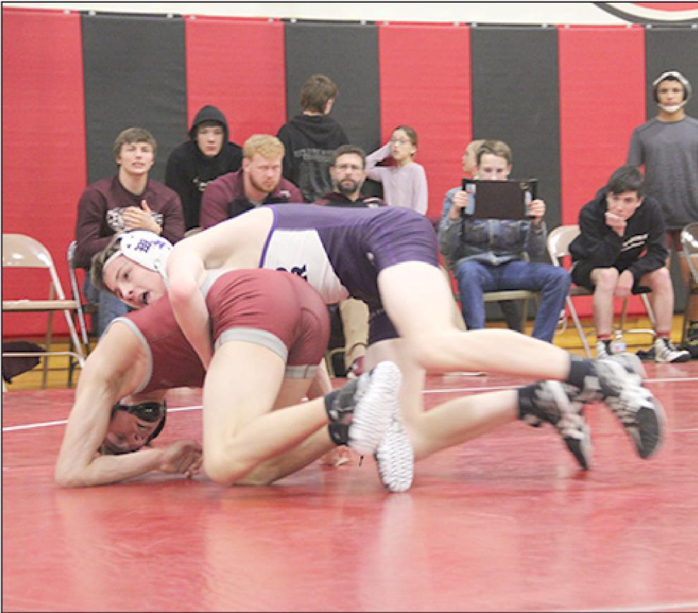 Nate Tillman, the Eagles 126 pound wrestler gets a takedown during one of his matches at the Rebel Duals in Loup City last week. (—photo by Amber Price)