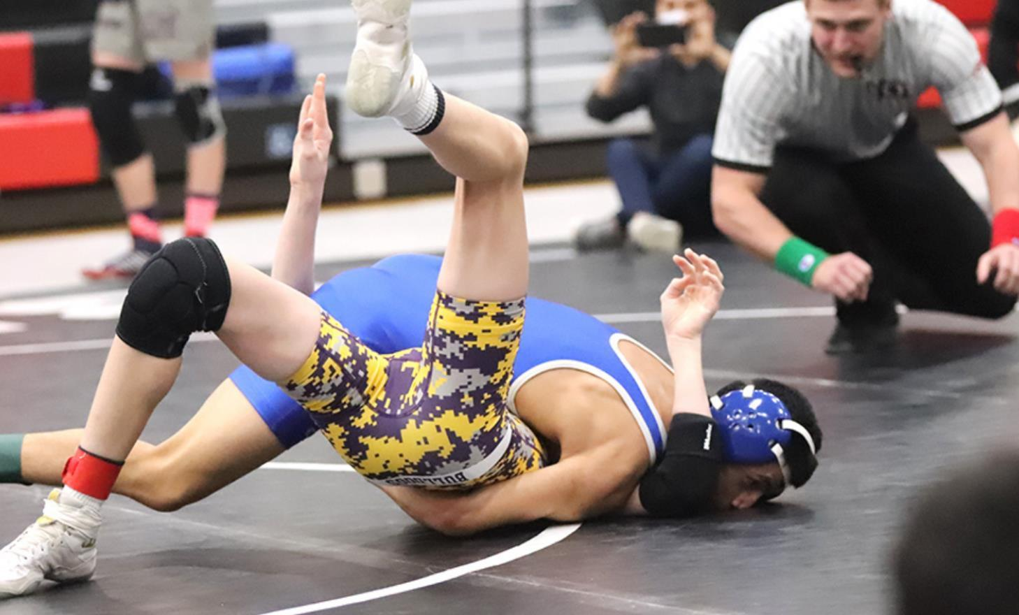 Jose Escandon, wrestling at the Class C-4B Sub-district last weekend, pins a Bridgeport foe. Escandon earned first place at 113 pounds and will join teammates Ruben Hernandez, Andres Aguilar, Jesus Hernandez, and Daniel Yepez at the district meet in Valen