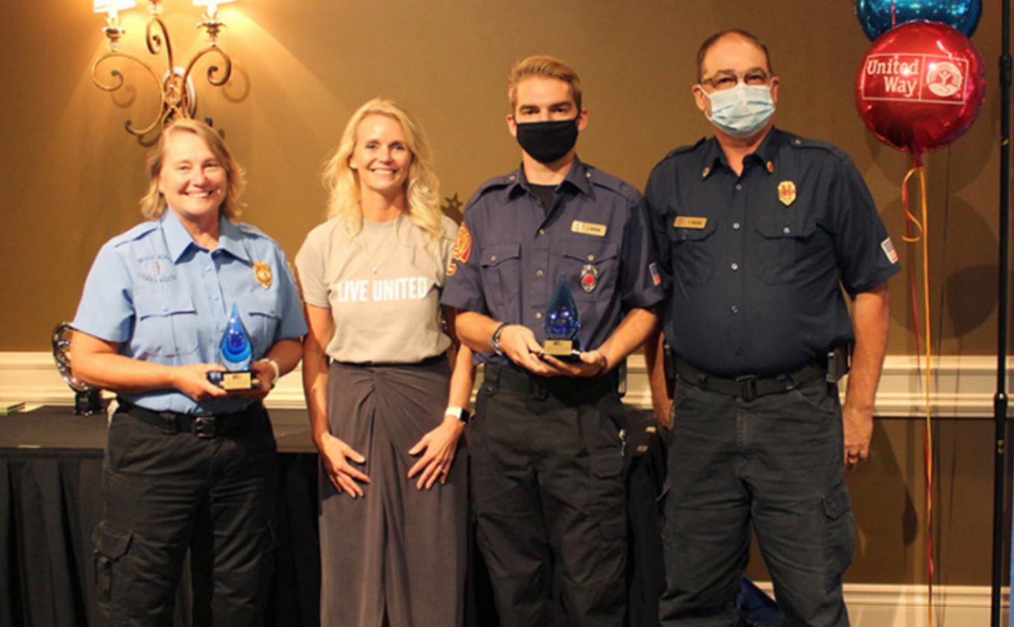 """Heartland United Way President Karen Rathke recetly presented Wood River and Dannebrog first responders with """"Be the One"""" Awards for their work in battling the 2019 floods. Pictured above, left to right, are Jenie Maloney, president of Wood River Fire"""
