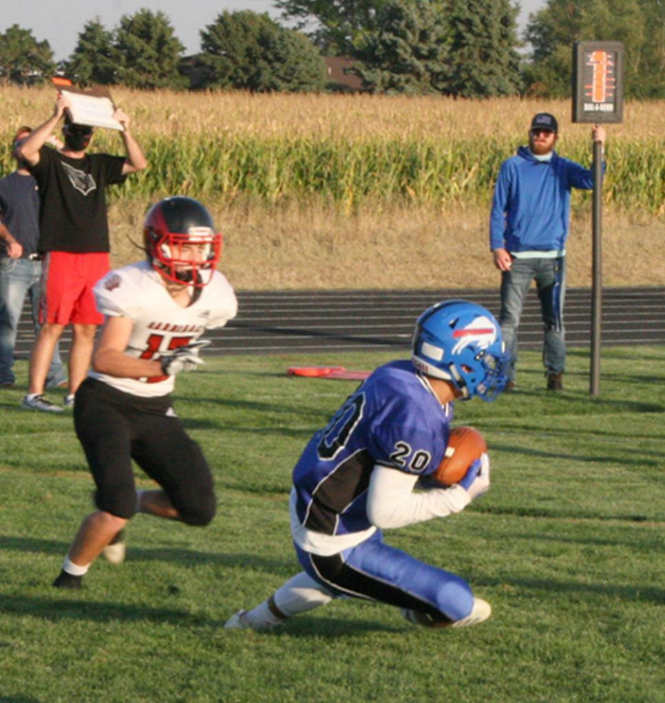 The Buffaloes drew first blood against visiting Doniphan/Trumbull last Friday night in Gibbon on a pass reception by Carlos Tamayo on the way to a home field victory. (–photo by Dennis Walker)