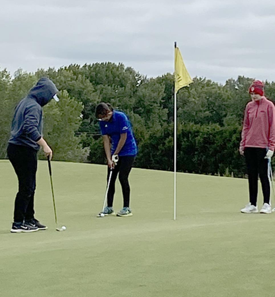 """Jiromi Corona putts to finish up a round of girls golf at the Awarii Challenge last week. According to head coach Carolyn Reinertson, Jiromi, """"Hit her five wood from the fairway consistently and managed the big greens pretty well."""" (–courtesy photo)"""
