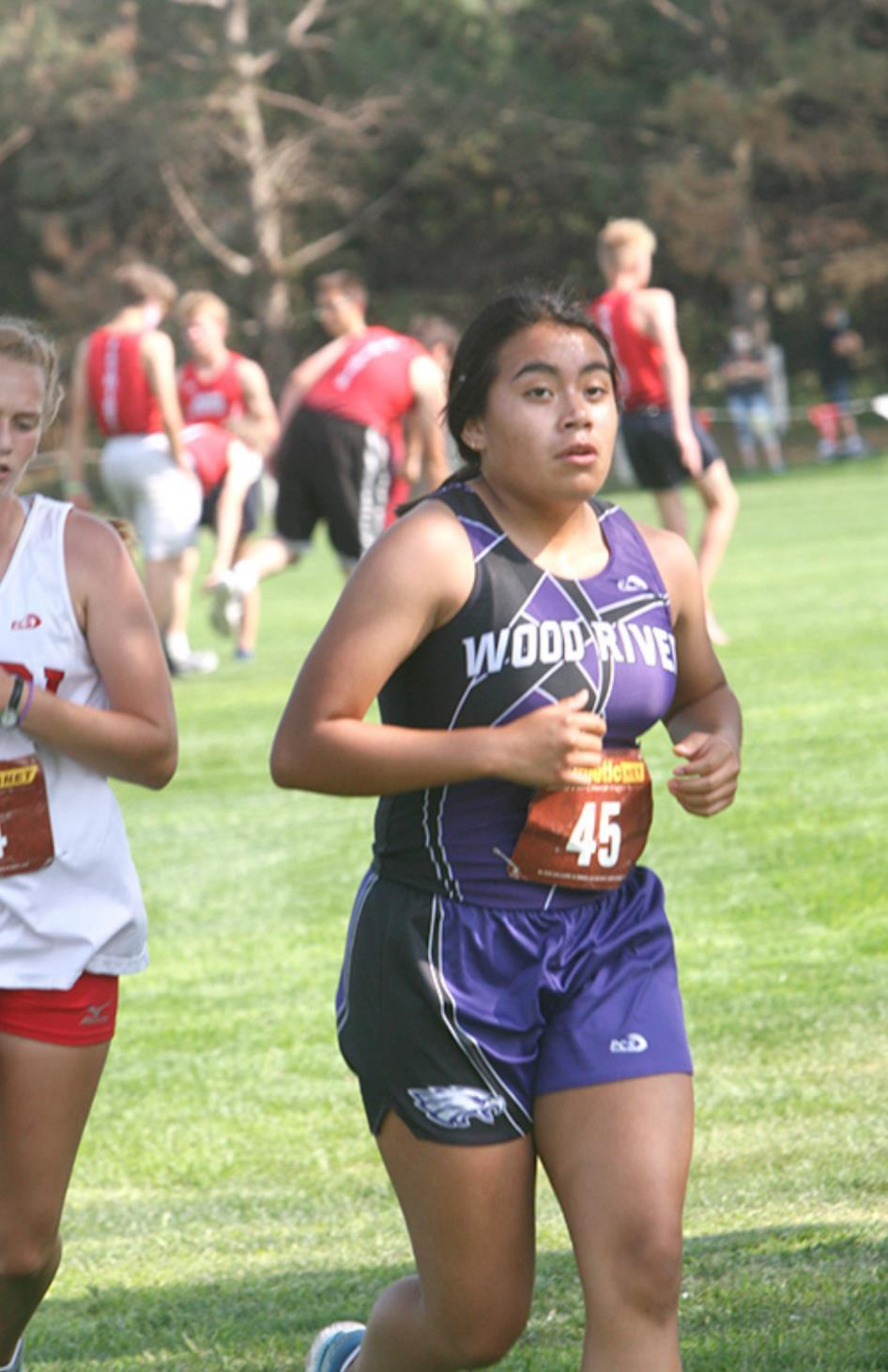 """Hensly Alvarado ran very close to an eight-minute mile,"" was Coach Gretchen Wiseman's praise for Wood River's sophomore runner. She placed 24th in the field of 37 runners at the Grand Island Northwest cross country meet last week. (—photo by Ly"