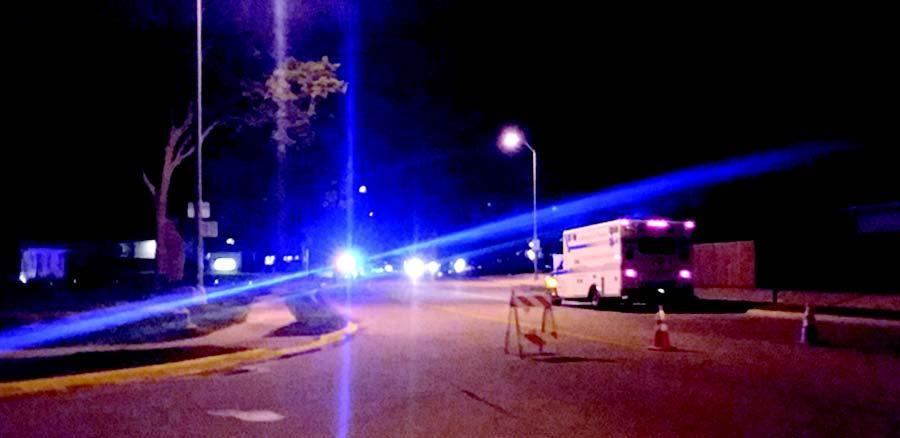 A portion of Court Street was blocked from traffic for about four hours early Saturday morning in Gibbon during a shooting incident which claimed two lives and one injury. (–photo by Dennis Walker)