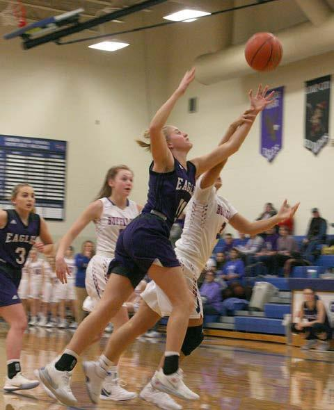 Boston Boucher battles Gibbon's Yahyda Castenada for a rebound in the ladies' edition of the annual Highway 30 rivalry last weekend. (–photo by Dennis Walker