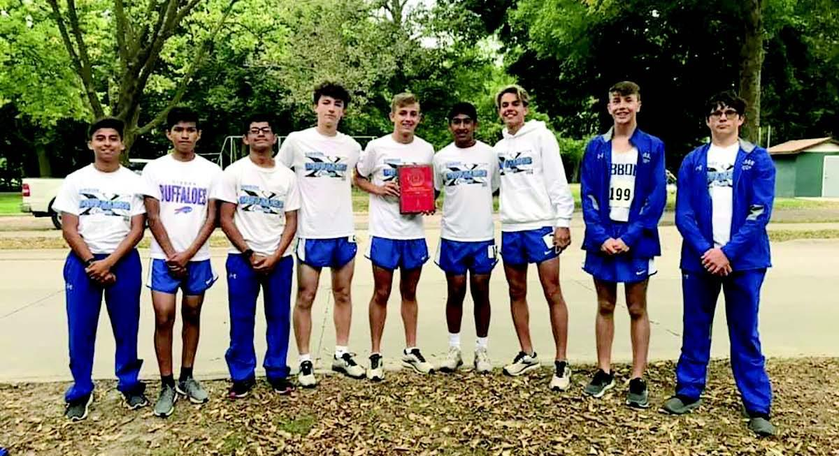The Gibbon boys cross country team earned first place at last week's Ord Invitational. The meet champions included, left to right, Junior Tovar, Emanuel Martinez, Jose Escandon, Kadin Hines, Nathan Holcomb, Andres Aguilar, Kaleb Pickel, Brayden Behrents, and Levi Gillming. (–courtesy photo)