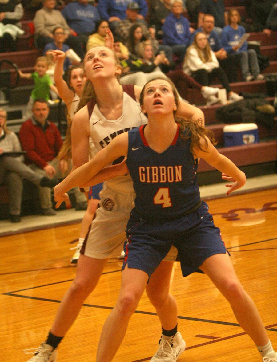 Gibbon's Kaylee Palmieri (#4) boxes out Centura's Elayna Holcomb in the LouPlatte Conference battle last week which was won by the Lady Centurions. The two teams meet again in the conference tournament Monday night at Centura at 7:00 p.m. (–photo by Lynn McBride)