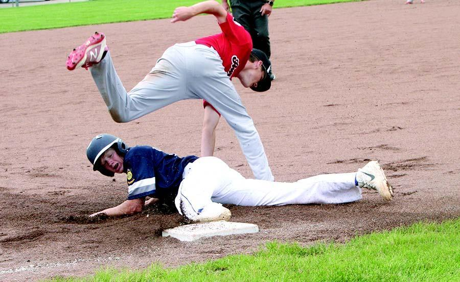 Hunter Shiers hits the deck against Aurora. He banged out a double in the game. (—photo by Lynn McBride)