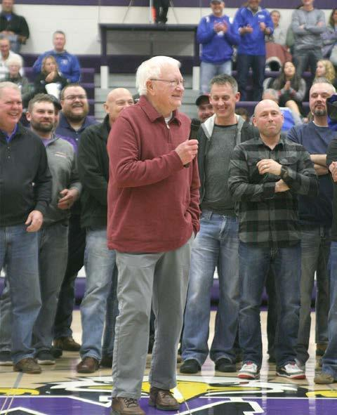 Long-time Wood River Rural High golf, basketball, cross country and track coach Dale Smidt was recognized for his accomplishments between the varsity boys and girls basketball games last Friday, January 4, at Wood River Rural High surrounded by a number of those he coached over the years. (–photo by Lynn McBride)