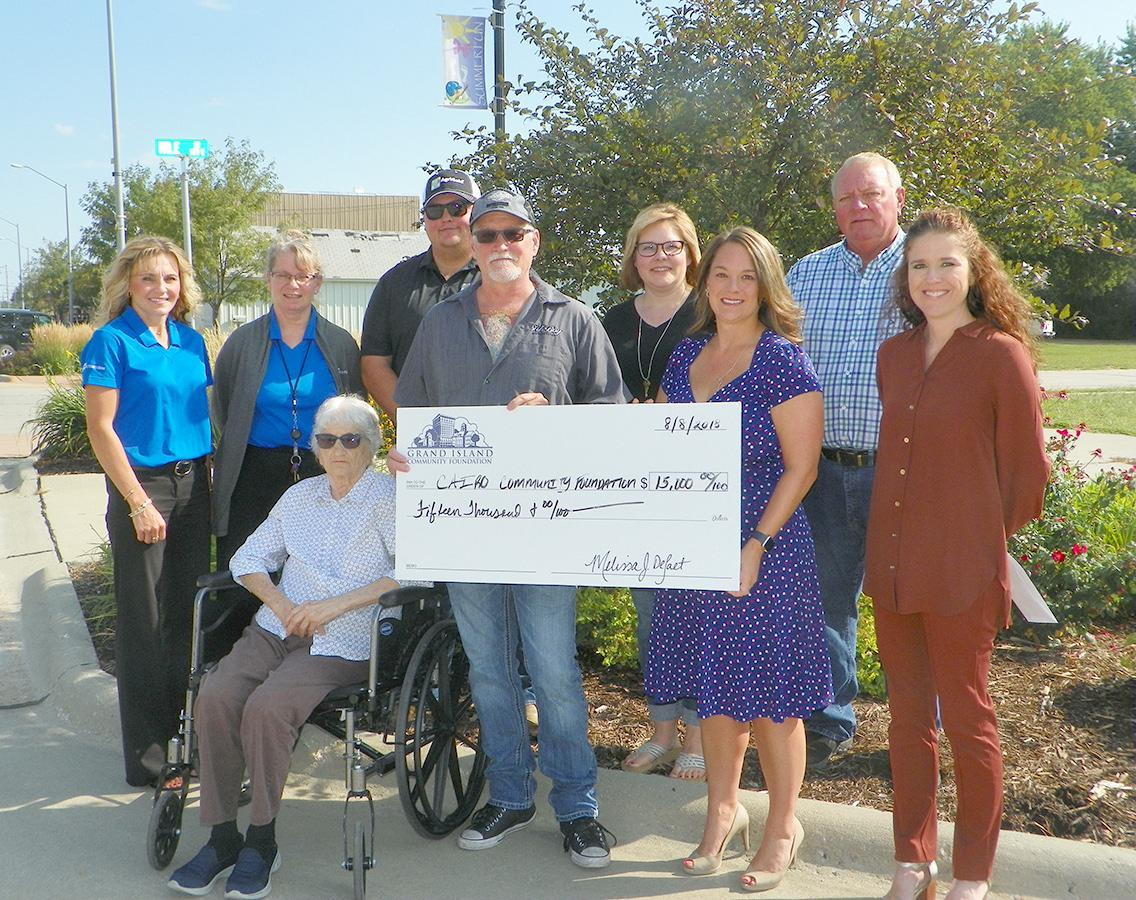 Members of the Cairo Community Foundation recently accepted a grant which was awarded by the Grand Island Community Foundation Dunlap Fund in the amount of $15,000 to go towards the building of the Veterans Memorial Wall in Cairo. (–courtesy photo)
