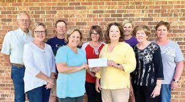 Members of the Wood River Community Centennial Foundation Board recently presented a check to Sara Arnett (front row, second from right) for the Stick Creek Kids Child Development Center in Wood River. (–courtesy photo)