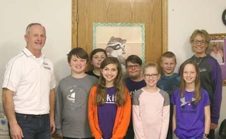 Shown with the HAL class members during the Clipper visit, Steve Glenn, publisher, is joined by, left to right, Robert McIntosh, Braden Carter, Elizabeth Gottlob, Talon White, Parker Lowe, Madden Brabec, Lila Morse, and teacher Betty Smith. (—photos by Lynn McBride)