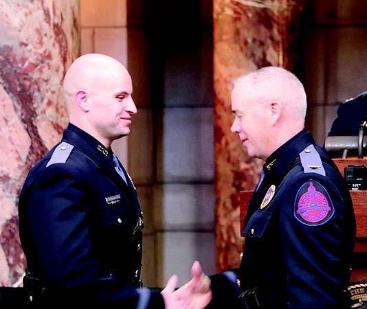Shelton graduate Ty Schoenefeld, left, is sworn in as a new member of the Nebraska State Patrol.