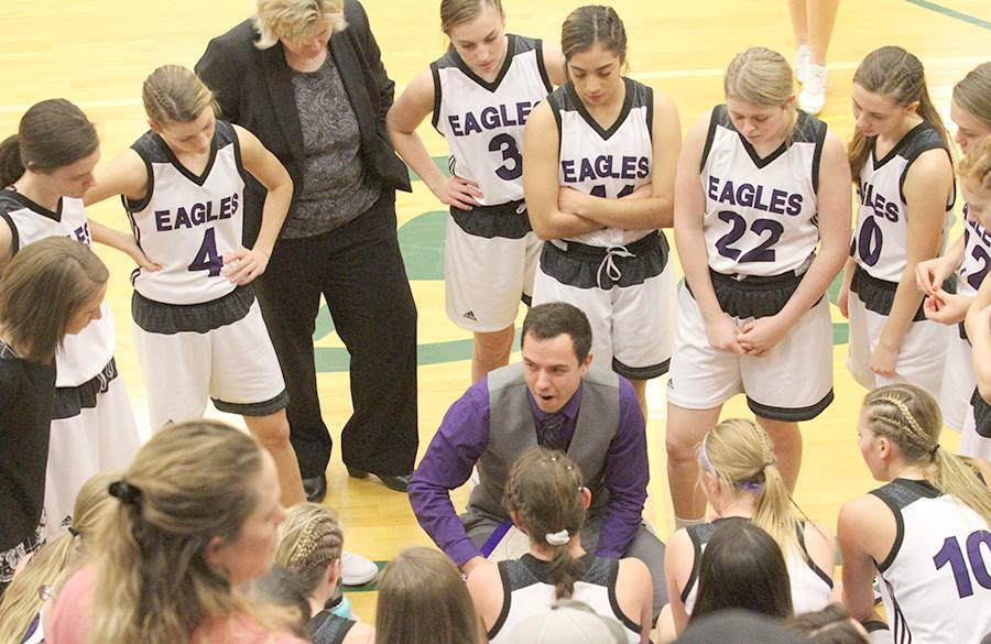 Wood River girls basketball coach Phil Smith goes over late game strategy with his players. The Lady Eagles played great defense on their way to winning the conference tournament title. (—photo by Steve Glenn)