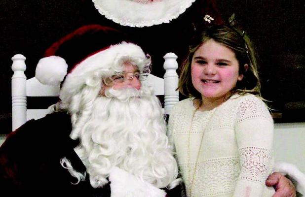 Santa collecting Wood River wish lists